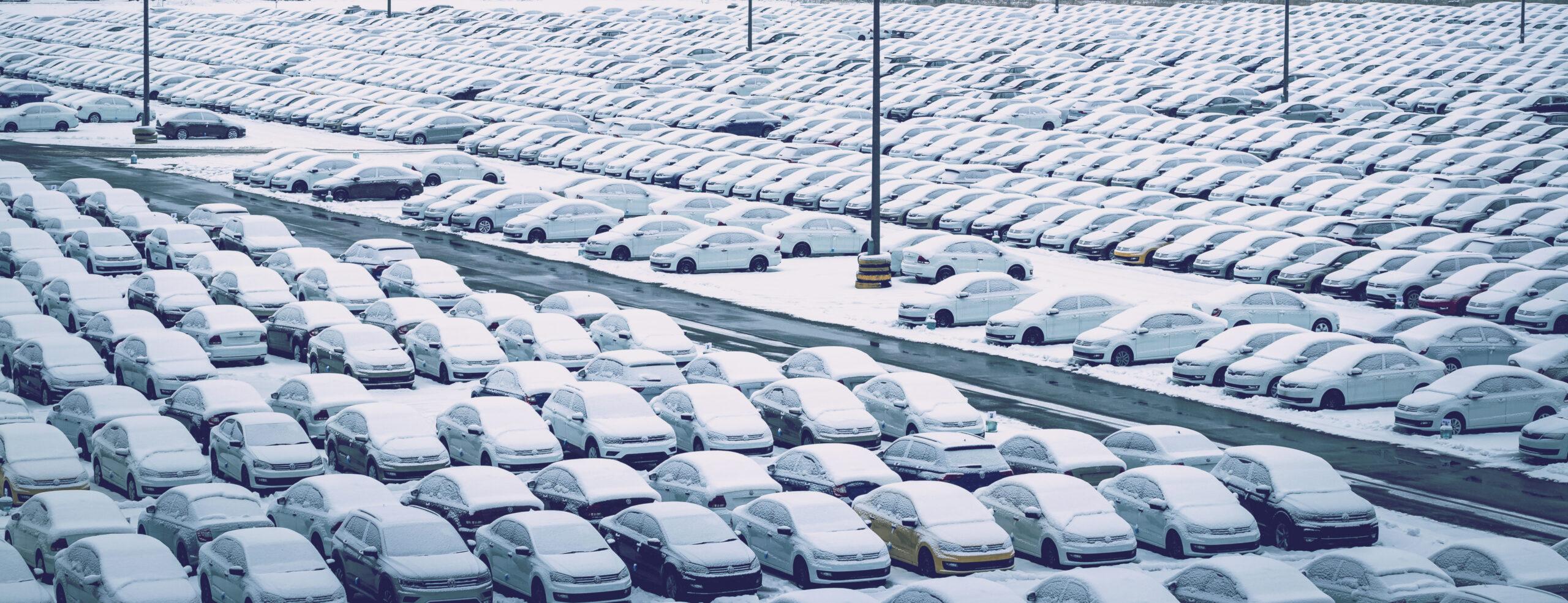 Cars in snow in car park