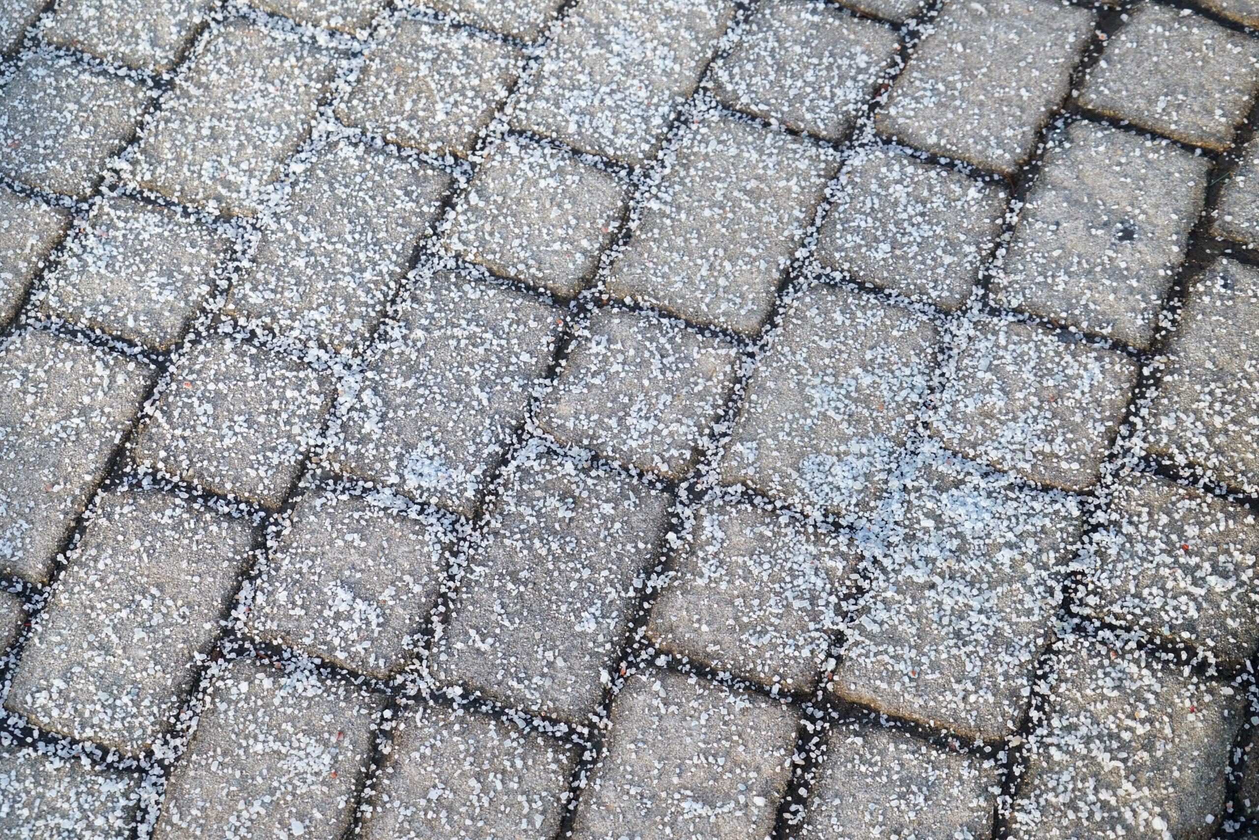 OUTCO winter gritting white salt on ground
